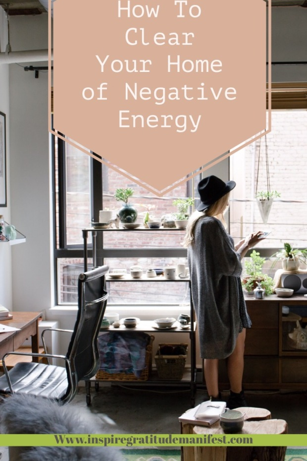 Home office with green plants, woman on phone, how to clear your home of negative energy